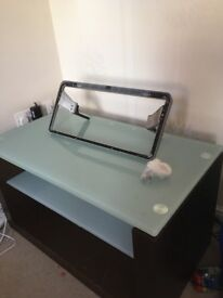 Wooden TV stand with glass top and a shelve
