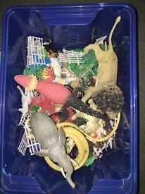 Box of plastic farm and zoo animals