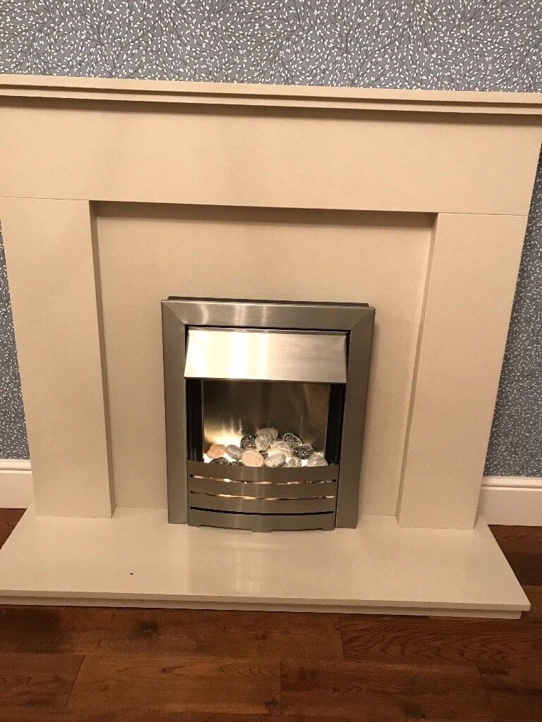 Marble fire surround with brushed steel electric fire