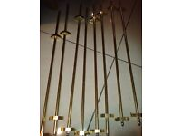 13 Brass Stair Rods with brass feet. The rods enhance carpeted or wooden stairs.