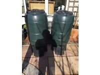Two water barrels with taps