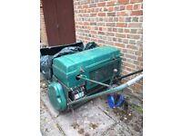 Robi reliant powered Allett cylinder mower.