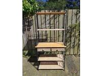 Rod iron shelving with wicker drawers