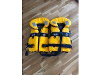 2 children's life jackets