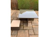 Rattan garden patio table with glass top and 4 footstools