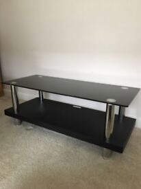 Black and chrome tv stand with safety glass top