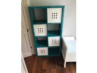 Ikea Kallax shelving unit with storage boxes
