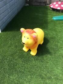 Ride on bouncy lion