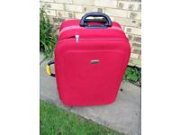LARGE RED SUITCASE 29INS X 16 INS
