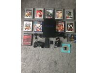 PS2 console with games and accessories