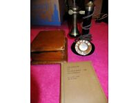 Candlestick telephone and bellbox c.1924 and Book of Telegraphy & Telephony c. 1929