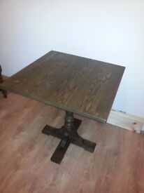 small solid wood dining table and two chairs