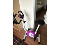 Exercise bike with calorie count, speedometer and timer