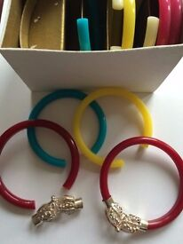 10 Indian bangles. Pink, yellow, red, white, blue. Silver spacer/catch/link.
