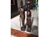 Pair of carved wooden statues