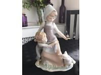 Lladro figurine, girl and boy with swan, perfect condition