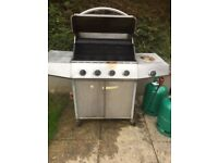 Large gas barbecue and 2 bottles