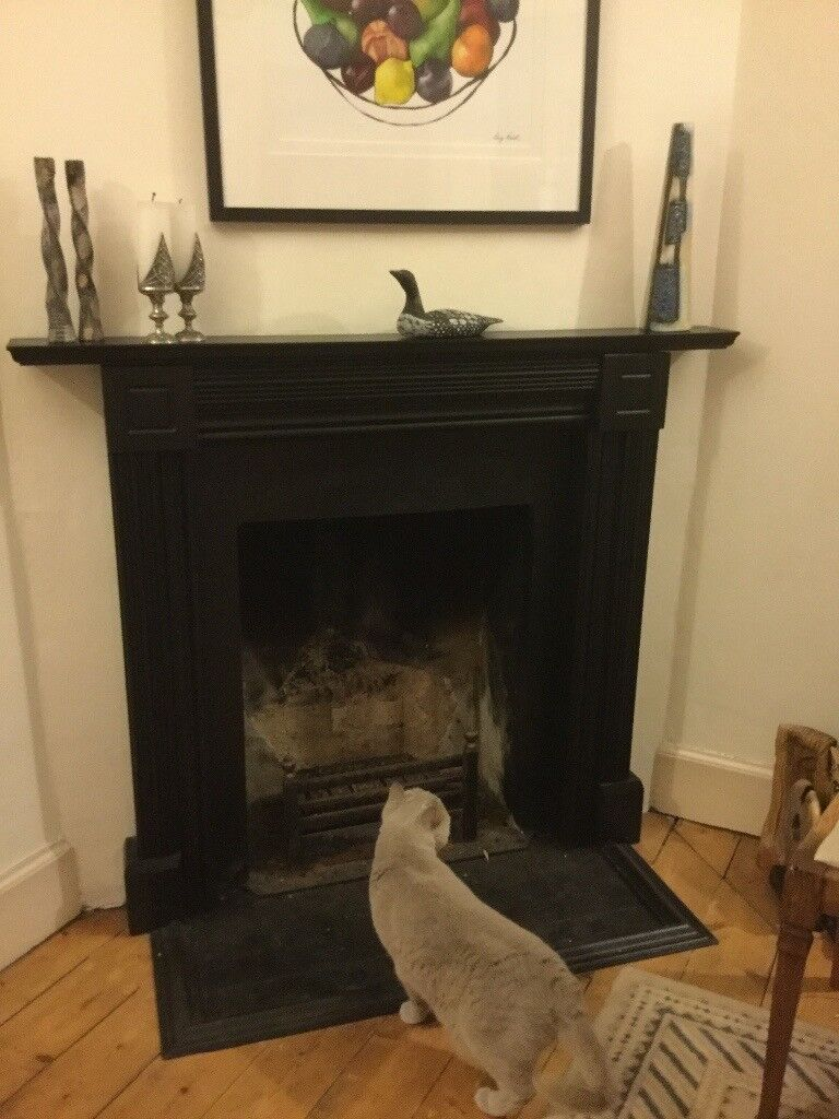 Stylish pine fireplace surround, painted black, good condition with FREE cast iron grate