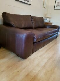 There piece leather suite and matching footstool