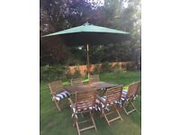 Garden table set plus chairs and umbrella