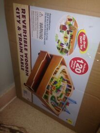 Brand new reversible city and train table set for sale never been opened