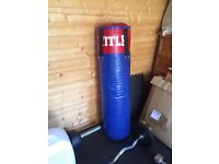 Full size punch bag with boxing gloves