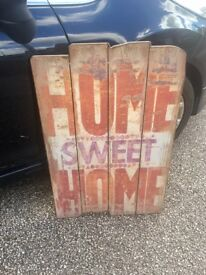 Large wooden 'Home Sweet Home' wall hanging