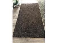 2 small ikea brown rugs