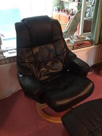 Black leather swivel armchair with footstool & massager