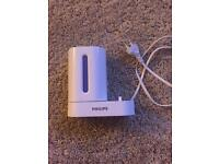 Phillips UV electric tooth brush head cleaner with charger. Brand new