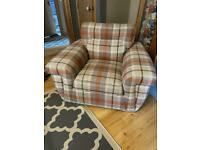 Orange tartan accent chair with scatter cushions
