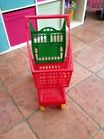 Children's red shopping trolley