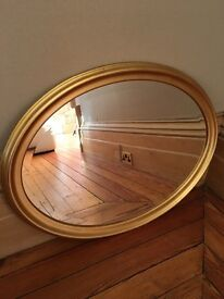 Beautiful gold effect oval mirror