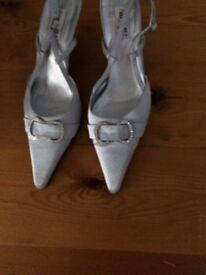 Evening silver sling back kitten heel