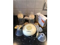 Medala Swing electric breast pump with bottles