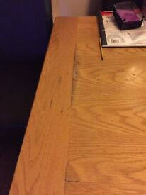 Oak table and 6 leather suede chairs. Damage to table see photo