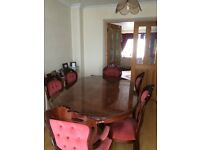Dining table 4 standard chairs 2 arm chairs 2 base cabinets 1 sit on glass cabinet
