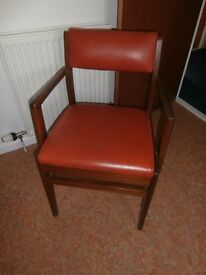 vintage solid wooden chair with the red vinyl seating - see photos as little tear