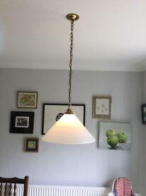 Pendant wall light. White glass on brass chain.