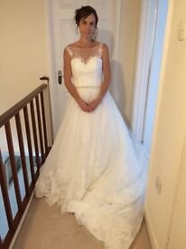 Gorgeous Ivory Wedding Dress - size 10 unaltered and brand new with tags.