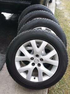 MAZDA CX5 KUMHO HIGH PERFORMANCE ' H ' RATED ALL SEASON TIRES ON FACTORY OEM ALLOY WHEELS.