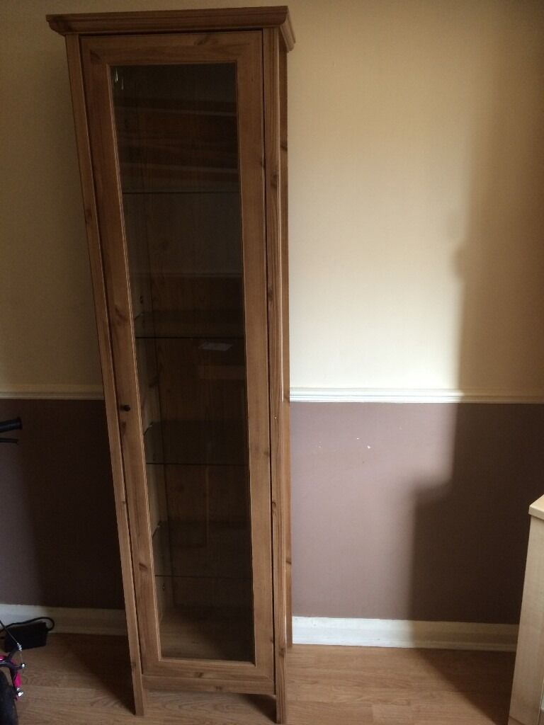 unit oak colour with glass shelves and door very good condition 13x18x75 inchin South Shields, Tyne and WearGumtree - unit very good condition glass shelves and door sizes 13x18x75 inch call for more details