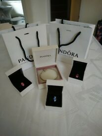 Pandora bracelet and three Pandora charms