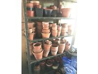 A selection of terracotta/plastic pots in various sizes