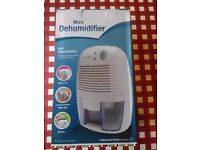 Mini dehumidifier / No compressor / Air filter / Water Tank / 1 year old