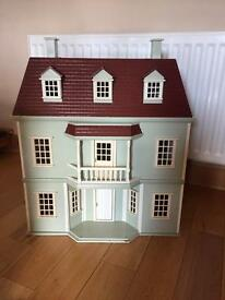 Traditional Dolls House with furniture.