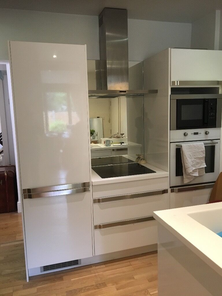 ikea white gloss kitchen units and chrome handles with. Black Bedroom Furniture Sets. Home Design Ideas