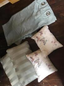 Teal curtains and cushions
