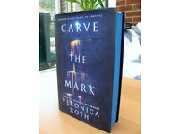 CARVE THE MARK VERONICA ROTH HARDBACK BLUE EDGED BOOK