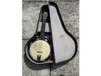 Melody Uke banjolele for sale. Comes with original case, new strings and tuning key